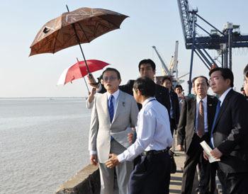 Point man: Taro Aso inspects a port near Yangon on Jan. 4. KYODO